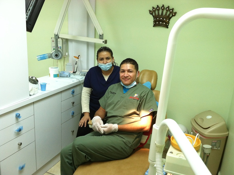 dentist and assistant sitting on dental chair