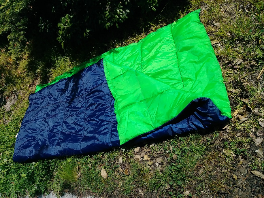 sleeping bag set on the ground