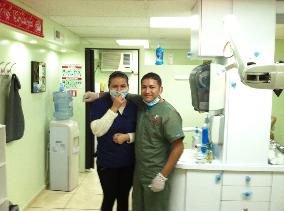 dentist and assistant in dental office