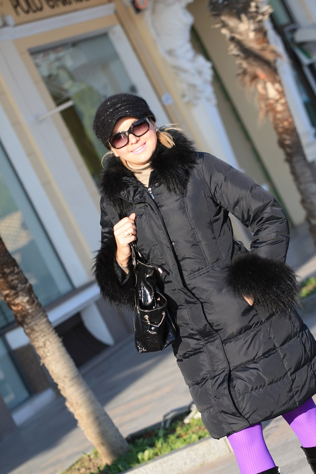 fashionable woman with coat, sunglasses and hat