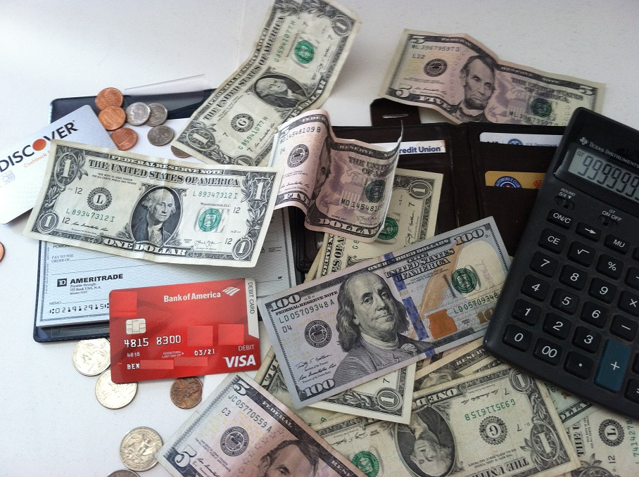 money, credit and debit cards and calculator