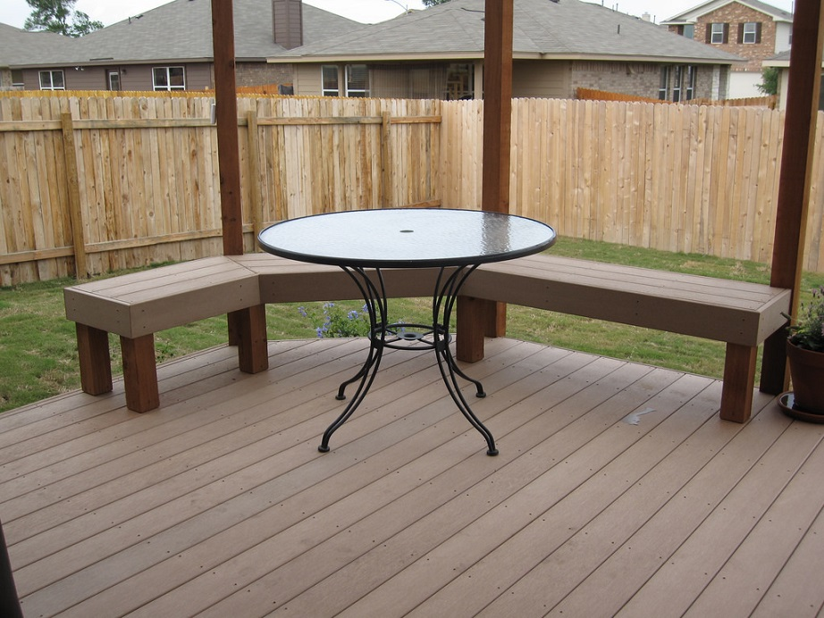 a deck with benches and a table