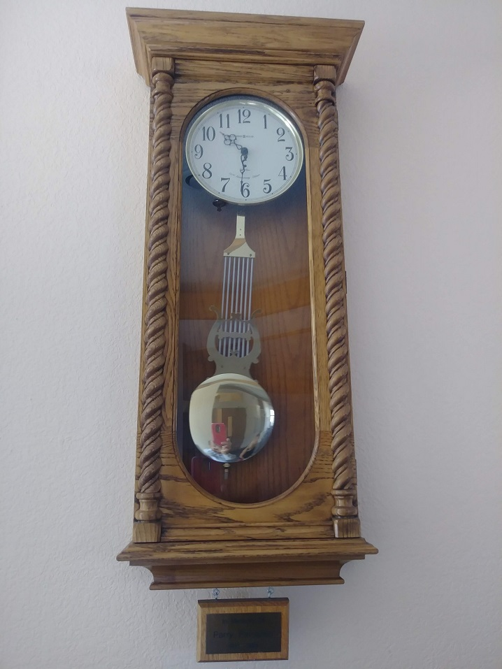 clock on the wall with pendulum