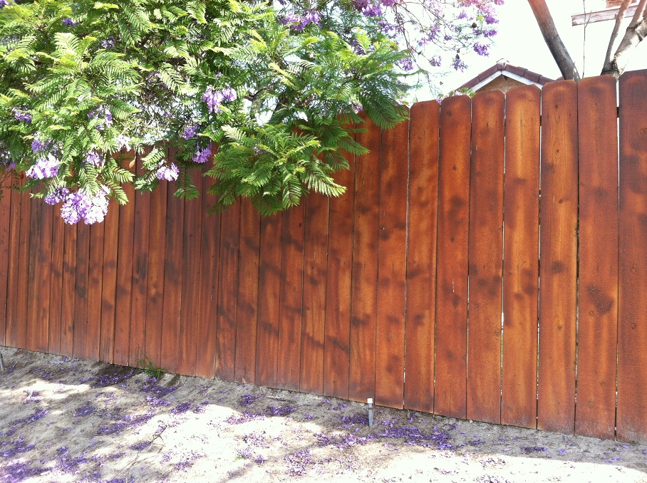 dark stained wood fence