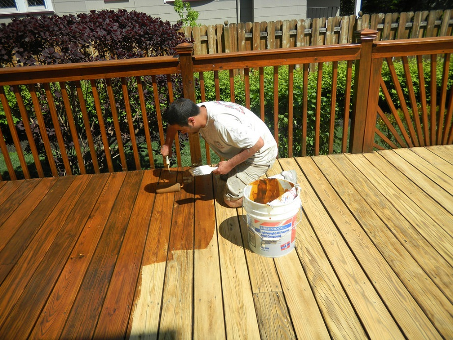 man staining a new deck
