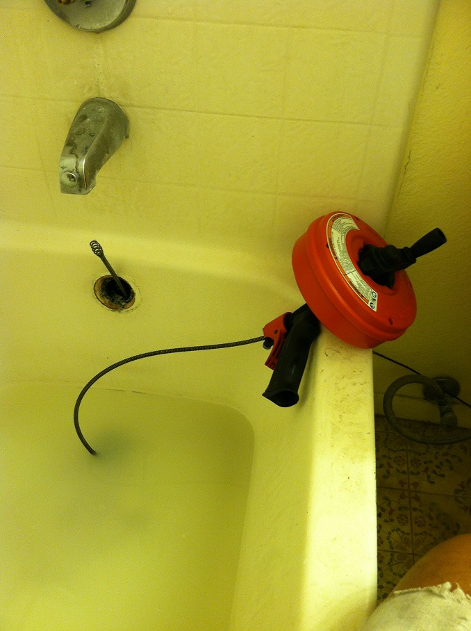 clogged bath tub drain with snake