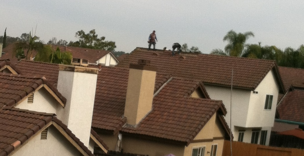 roofers working on roof