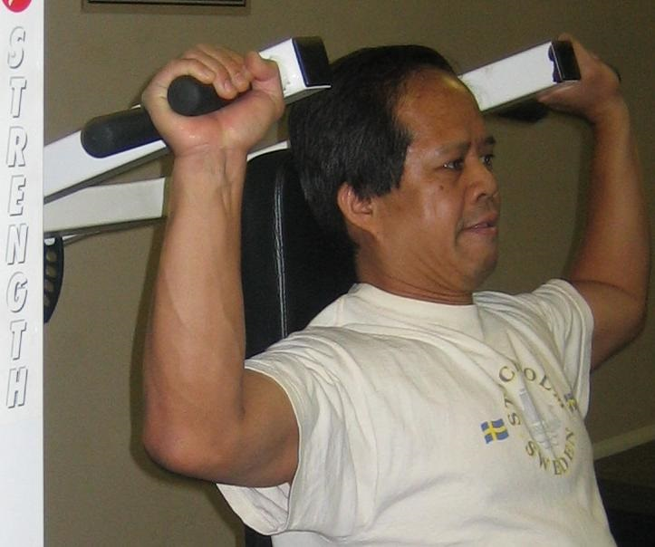 man lifting on machine weights