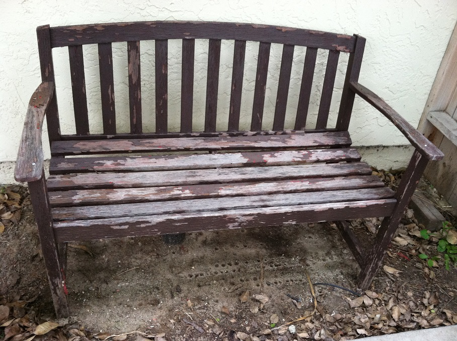 wooden bench in need of painting