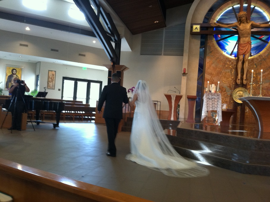 videographer captures bride and groom at altar
