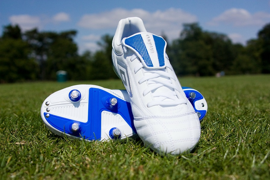 a pair of soccer shoes in grass