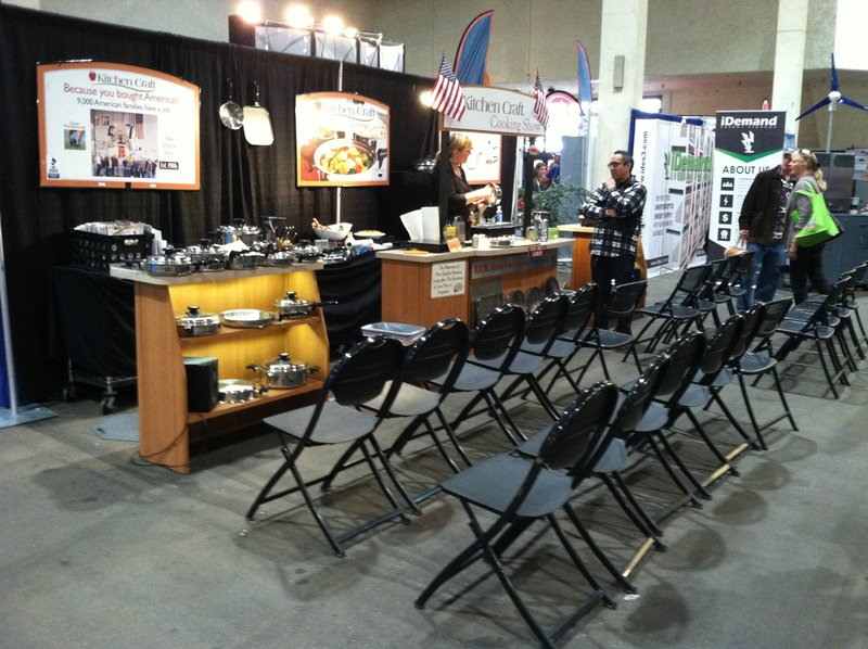 trade show booth with chairs for demonstration