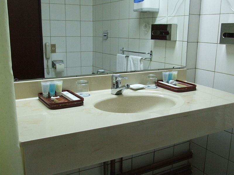 bathroom mirror, sink and faucet