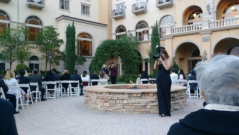 photographer at a wedding taking pictures