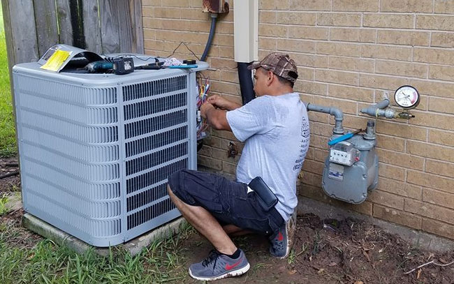 air conditioning professional servicing a home unit