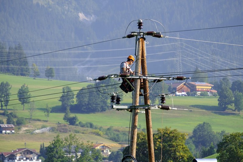 electrician at work on power lines
