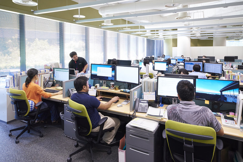 workers at computer workstation