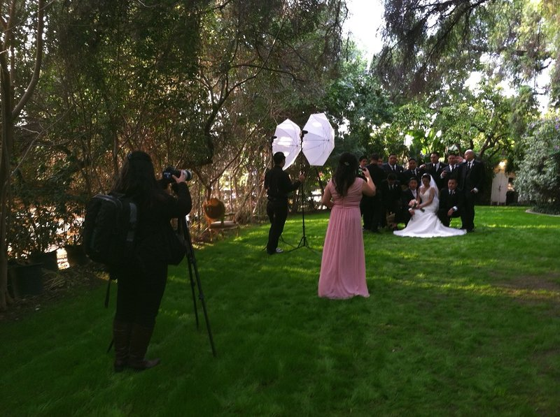 wedding photographers at work with their equipment