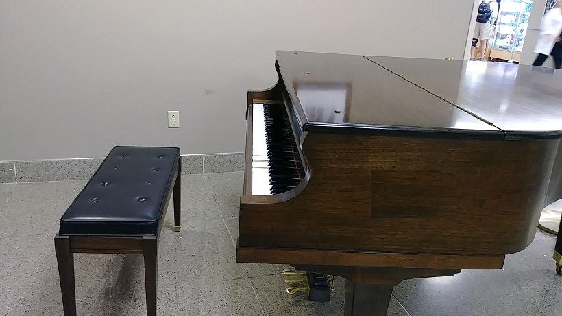 grand piano with bench